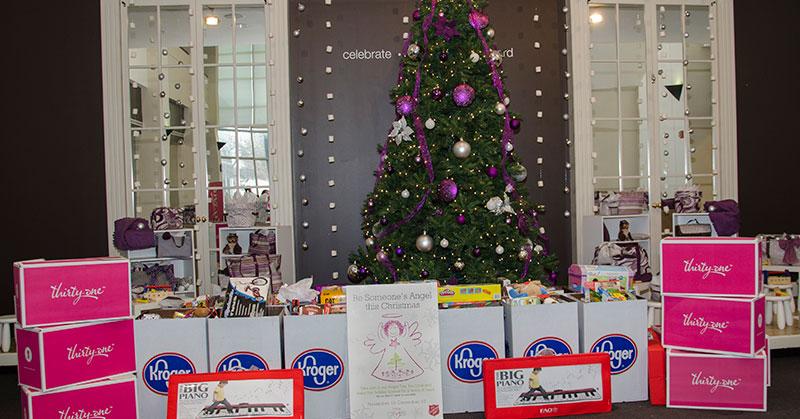 Salvation Army gifts around Christmas Tree